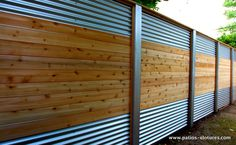 Hybrid fence with galvanized steel, aluminum and cedar that we built for Mrs. Lecompte in Laval.