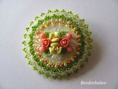 green beaded round pin