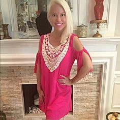Stunning pink and crochet dress! A solid crinkle rayon crochet lace bib shift dress with pom-pom lace on slit bell sleeve. Slight high-low hem. Fully lined. Non-sheer. Woven. Lightweight. Dresses