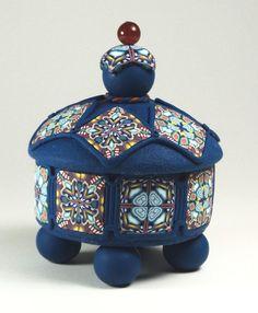 Polymer clay trinket box with cane decoration