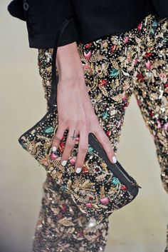 Beading on clutch and velvet pants.