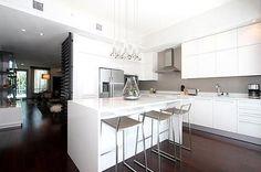 Contemporary Kitchen with Kitchen island, Breakfast bar, L-shaped, Pendant light, Hardwood floors, Limestone, Undermount sink