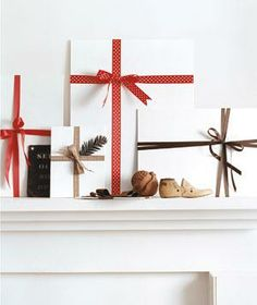 Wrap blank art canvases with colorful ribbon, then prop them up on a mantel.