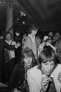 The Rolling Stones, Mick Jagger, Charlie Watts, Mick Taylor & a lady handing a flower to Jagger