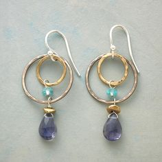 "INNER ORBIT EARRINGS -- Two hand-hammered hoops, one sterling silver, the other 14kt gold fill, orbit while apatite and brass-capped iolite wink and shine. Sterling silver wires. USA. Exclusive. 1-1/2""L."