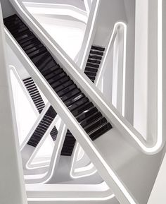 @zahahadidarchitects' Dominion Office Building consists of vertically stacked plates off-set at each level. Balconies project into the naturally lit atrium, with a series of staircases interconnecting and criss-crossing through the central space. : Hufton+Crow. #architecture #interior #design #interiordesign #zahahadid #staircase... - Interior Design Ideas, Interior Decor and Designs, Home Design Inspiration, Room Design Ideas, Interior Decorating, Furniture And Accessories