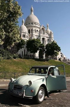 A Citroen deux chevaux in front of the Sacre Coeur