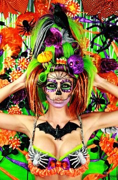 """diadelosmuertosmask: """" An interesting modern interpretation of the Dia De Los Muertos theme. Extremely colorful which is different, but I like all the stuff in the hair which always plays prevalent in a good DDLM outfit. """""""