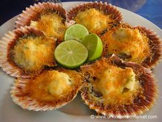 Conchitas a la Parmesana (parmesan gratinated scallops): Rich and buttery. Scallops topped with grated parmesan and baked just brown.