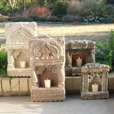 Imagine sitting in your garden meditating or remembering someone in front of these little lamps or shrines.  Awesome!