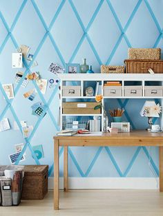 In a basement hobby room or office, turn one wall into an oversize message board. This treatment works in for basements where humidity and moisture are not a problem. And this treatment helps reduce noise and echoing.  Staple batting and fabric to the wall before installing the baseboard and crown molding. Stretch wide ribbon on the diagonal from floor to ceiling to make diamonds. At each intersection of diagonals, hammer in a decorative furniture tack to create a tufted look.