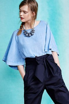 We love this Chambray Kimono Top from #anthropologie to help balance a rectangle or triangle body shape. Learn how to dress your body shape and find items that work best for you while helping women in need at Styleruist.com!