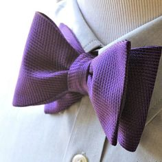 The perfect shade of purple. A solid regal purple bow tie creates a strong and interesting pattern just from the weave. The complex texture of the silk provides visual interest but at the same time the singular color allows greater flexibility in outfit pairing from casual to super formal.   Www.bowtieclub.com (Regal Purple) . . . . . . . . . . . . . . .  #bowtie #bowties #thebowtieclub #handmade #bowtiethursday #bowtieclub #bowtiegame #purple #styleblog #fashionblogger #dapper #mensfashion…