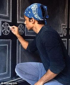 All in the details: In other shots he can be seen drawing outlines and designs over entire rooms Rajiv Surendra, Kevin G, Chalk Artist, Lindsay Lohan, Mean Girls, Outlines, Murals, Rap, Acting