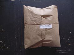 [brown paper packages tied up in string]
