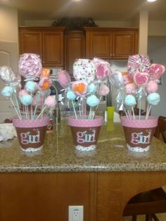 Baby shower center pieces @Lindsey Faucher Collins @Debbie Arruda Collins What if we did this in the buckets with cake pops?