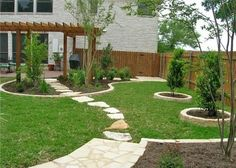 stepping stones leading to different areas in a large backyard
