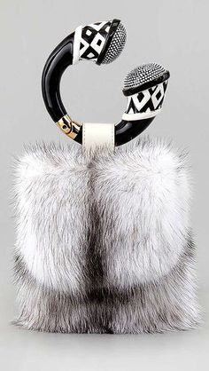 Tom Ford Mink Fur Bracelet Bag. Normally would not be in my register of style, but I the extravagance of this is really luring me in...