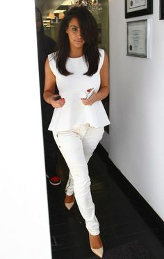 Kim Kardashian in white peplum top