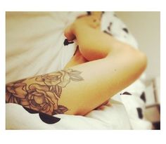 upper leg rose tattoo