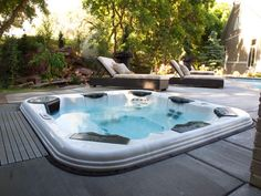 Recessed Portable Spa (Long Island/NY): Installing a Bullfrog Spas' Spa Vault inside a cutout in the deck, safeguards the hot tub while giving it the appearance of a traditional in-ground spa. Photo: Bullfrog Spas http://www.longislandhottub.com/longisland_hot_tub_spa_blog/?p=2699
