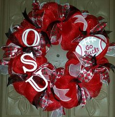 This is a 24 Ohio State deco mesh wreath made of red, white and silver deco mesh and ribbons and a hand painted wooden football and painted O S U letters. ALL custom wreaths and hand painted glasswar Ohio State Wreath, Ohio State Crafts, Christmas Mesh Wreaths, Holiday Wreaths, Christmas Crafts, Winter Wreaths, Spring Wreaths, Summer Wreath, Buckeye Crafts