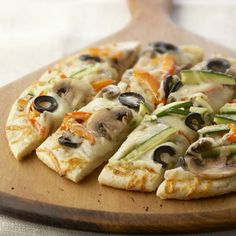 Vegetable and cheese-topped pizza crust, cut into squares, make an easy party appetizer.
