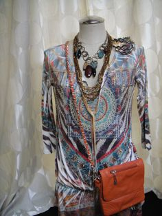 Beautiful & unique lightweight blouse.  Abstract pattern with different color rhinestones on the front.  Size M/L.  Check out the accessories to go with it!