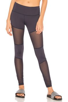 On SALE at 25% OFF! Whitmore Legging by Varley. 70% polyamide 30% elastane. Stretch fit. Waistband slit pocket. Contrast sheer mesh panel accent. VARR-WM92. VAR00093.