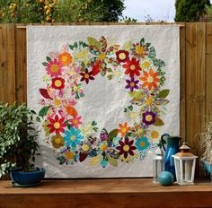 'Flowering Wreath' uses appliqué to create a vibrant garland from solid or patterned fabric. This pattern is perfect for all types of Applique methods, machine, raw edge and needle t…