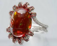 Martin Katz white gold ring with a oval red opal cabochon, microset with diamonds, tsavorite garnets and orange-red sapphires. Opal Jewelry, Jewelry Rings, Silver Jewelry, Fine Jewelry, Women Jewelry, Jewlery, Silver Earrings, Red Opal, Red Sapphire