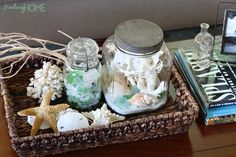 great ideas on how to make a beach terrarium... fabulous for above the toilet lid decor, and beach themed bathrooms!