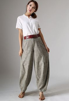 Stay comfortable and look terrific all season long with these beige linen pants. Linen is an ideal choice for clothing and can be best described as an all weather fabric.  These go-to pants with loose-fitting wide legs will have you looking casually smart and are also extremely comfortable to wear. Youll be able to pair this pair of linen pants with a tank and sandals equally well as with winter boots and a sweater. This really is a versatile pair of pants. The neutral color will also help…
