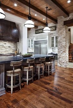 Interior Black Vintage Wood Cook Hood Inverted Bowl White Glass Hanging Lamp Exposed Brick Wall Dark Brown Laminated Wooden Floor Low Old Style Stool Grey Marble Island Countertop Silver Stainless Steel Refrigerator Arched Bronze Faucet Natural Wood Interior Design Ideas