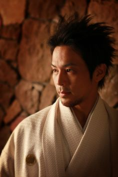 Man in Kimono (all white!)--embroidered mon on the chest.