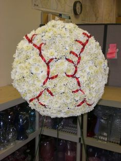 Funeral piece for a true baseball fan. #passare #leavewell #planwell #funeral #death #flower #grave