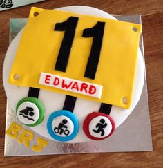 Adapting a shop brought cake (had flowers  butterflies on) and turned it into a Triathlon cake for my son