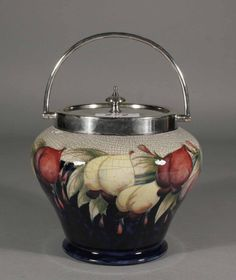 A Moorcroft biscuit barrel with silver plated moun :