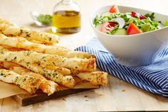Try these simple breadsticks with fresh summer herbs and your favorite local cheeses.