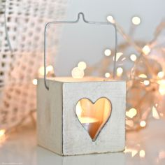 Whether you're eating al fresco or reading a book by the fire this pretty white wooden tea light holder will ensure everything looks beautiful by candlelight. DIMENSIONS: 6cm x 6cmNever leave a burning candle unattened.