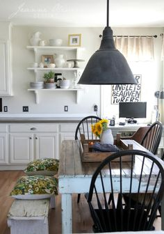 love the distressed dining table/bench...