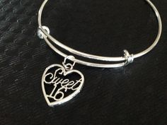 Sweet Sixteen charm is securely attached on a Silver Plated Expandable Bangle. Teenager Gift Ideas! *(Most appreciated Gift hanging on a Gift Bag)* Meaningful Charm Bracelet; great gift idea! This can