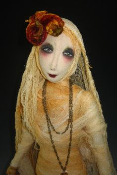 Mummy Dearest is an 18 art doll who is preparing to meet her groom. With her veil and bouquet, she anticipates the music of the night. All fabric