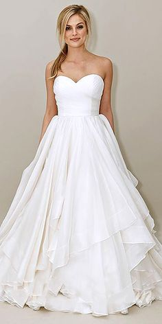 Artistic Wedding Dresses, floral Wedding Dresses, non-traditional Wedding Dresses. Brides today have a hard time choosing their Wedding Dress style. If you are not sure what wedding gown to choose, stop on the classic wedding gowns. They are timeless and work nice for every wedding...