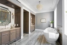 Like the floor of the bathroom and the tub. Wish the tub was in front of a window to look out! Rupert Murdoch Re-Lists New York City Townhouse Nyc Apartment, House Design, Townhouse, West Village Townhouse, Nyc Townhouse, Townhouse Interior, Grey Walls, Large Bathtubs, City Living