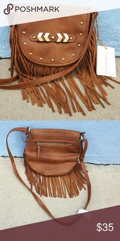 Fringe Crossbody Bag Brown crossbody / shoulder bag. Fringe detailing add fun accent to bag and is exactly on trend for fall / winter months. Gold military inspired detailing gives a classic pop of color. Bag is new. NEVER WORN Bags Shoulder Bags