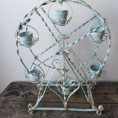 Ornate metal Ferris wheel candle holder shabby by AnitaSperoDesign