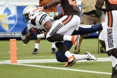 San Diego Chargers wide receiver Keenan Allen, left, makes a leaping catch into the end zone for a touchdown against the Cleveland Browns during the first half in an NFL football game Sunday, Oct. 4, 2015, in San Diego.