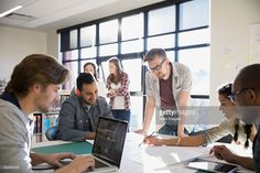 Stock Photo : Business people reviewing blueprint in office