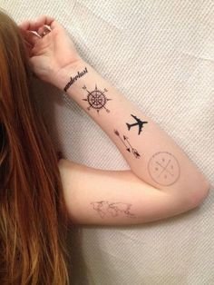 Wanderlust with Compass, Airplane and Arrows Tattoos | Wanderlust Compass Tattoo on Arm